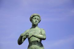 Beautiful sculpture of a woman. In the park Stock Photography