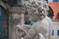 Beautiful sculptures of angels in Zwinger Dresden, Germany. The Zwinger is a palace in the eastern German city of Dresden, built in Baroque style and designed by stock photo