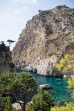 Beautiful sea bay with remains of medieval castle. Beautiful Delik Deniz sea bay with pristine waters and  remains of medieval castle on top of rock in Guney Royalty Free Stock Photography