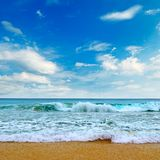 Beautiful sea and blue sky. Picturesque and gorgeous scene. Beautiful seascape and blue sky. Sand beach. Picturesque and gorgeous scene royalty free stock photo