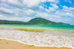 Beautiful sea curve sand beach with green trees on the moutain. Beautiful sea and clear crystal water then curve sand beach with green trees on the moutain then Royalty Free Stock Photos