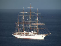 Beautiful sea cloud with sails furled. Sea cloud, motoring into the shelter of admiralty bay, bequia Stock Photos