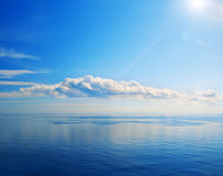 Beautiful sea and cloudy sky with sun Royalty Free Stock Photo