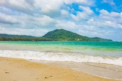 Beautiful sea curve sand beach with green trees on the moutain. Beautiful sea and clear crystal water then curve sand beach with green trees on the moutain then Royalty Free Stock Photo