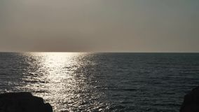 Sun reflection into the sea. Beautiful sea at dusk with bright sun reflection on the waves stock video