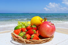 The beautiful sea and fresh fruits Royalty Free Stock Images