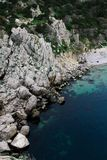 Beautiful sea harbor surrounded by cliffs and forest. Clear seawater and visible seabed. Crimea, Simeiz. Beautiful sea harbor surrounded by cliffs and forest stock image