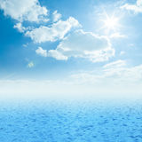 Beautiful sea horizon with clouds above it. Blue sea, sun and clouds on sky Royalty Free Stock Photography