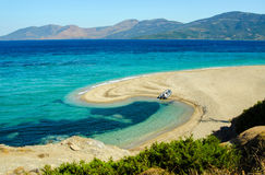 Beautiful sea lagoon with boat on beach. In Greece Royalty Free Stock Photos