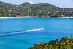 Beautiful sea landscape, blue tropical ocean and green hills Stock Images