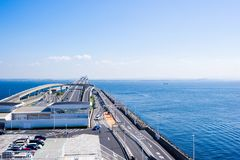 Beautiful sea level with highway road in Umi Hotaru parking area island Tokyo bay aqua line, Japan. Panoramic bird eye top aerial view with beautiful sea level royalty free stock photo