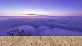Beautiful Sea of Mist on Poo Chee Fah ,Chaingrai , Thailand. And wooden fkoor royalty free stock photos
