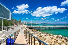 Beautiful sea promenade with palms, sculptures and pools in Limassol, Cyprus royalty free stock image