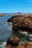 Beautiful sea with rocks under blue sky. Beautiful sea with volcanic rocks under blue sky. Tenerife. Canaries. Spain Royalty Free Stock Photography
