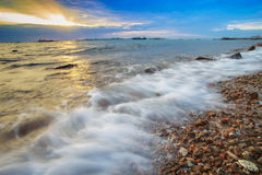 Beautiful sea scape and sun set sky by long exposure photography Stock Images