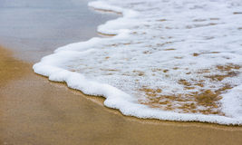 Beautiful sea summer abstract background - Golden sand beach with blue ocean waves Royalty Free Stock Photo