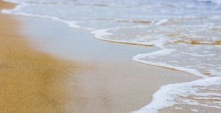 Beautiful sea summer abstract background - Golden sand beach with blue ocean waves Stock Images