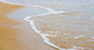 Beautiful sea summer abstract background - Golden sand beach with blue ocean waves Royalty Free Stock Photos