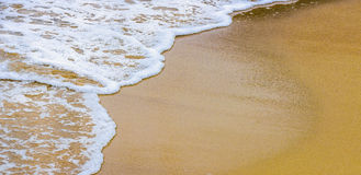 Beautiful sea summer abstract background - Golden sand beach with blue ocean waves Stock Photos