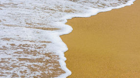 Beautiful sea summer abstract background - Golden sand beach with blue ocean waves Royalty Free Stock Images