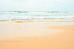 Beautiful sea summer or spring abstract background. Golden sand beach with blue ocean and cloudscape Stock Photography