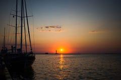 Beautiful sea sunrise. Sunset. Sunrise. Beautiful colors of sunrise. Lighthouse on the horizont. Big ship on the sunset. Place for text Stock Photography