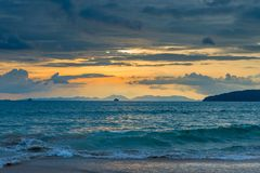 Beautiful sea during sunset, blue clouds over the sea and orange Stock Images