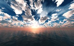 Beautiful sea sunset, clouds and sun above the water Stock Photo