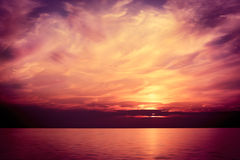 Beautiful Sea at Sunset. Majestic Background. Beautiful Sea at Sunset. Majestic Sky Background. Toned and Filtered Photo. Copy Space Stock Photography