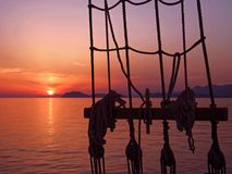 Beautiful sea sunset on old ship royalty free stock image