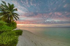 Dream scenery. Beautiful sunset over the tropical beach royalty free stock image
