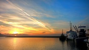 Beautiful sea sunset in the port royalty free stock photo