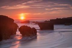 Beautiful sea sunset on the waves. Sandy beach. Royalty Free Stock Photos