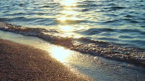 Beautiful sea surf at the sunrise time. Close up stock video footage