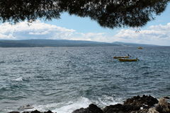Beautiful sea. Under tree in summer Royalty Free Stock Image
