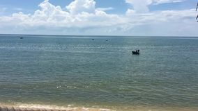 Beautiful sea of Vietnam. Beautiful sea with sunny beach in Phan Thiet, southern Vietnam. Phan Tiet, which is rather larger, is famous for its fish sauce, an stock footage