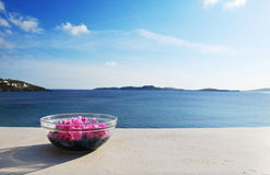 Beautiful Sea View. A bottle of spa flower on the balcony face to aegean sea Stock Photos