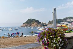 Tossa de Mar, Catalonia, Spain, August 2018. Beautiful sea view of the beach and the bay, the old castle on the cliff. royalty free stock photography