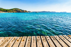 Sea view of the coastline on Majorca Island, Spain. Beautiful sea view at coast from the wooden pier at the bay of Paguera Majorca, Balearic Islands Mallorca Royalty Free Stock Photos