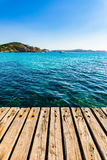 Idyllic sea view at the coast of Majorca Island, Spain. Beautiful sea view at coast from the wooden pier at the bay of Paguera Majorca Spain, Balearic Islands Royalty Free Stock Image