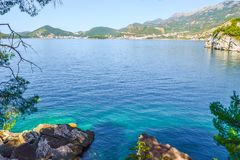 Beautiful sea view. The mountains descend into the sea. Blue sky and turquoise water. Adriatic Sea. Montenegro. Beautiful sea view. The mountains descend into royalty free stock photos