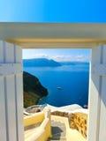 Beautiful sea view from the open gate. Santorini island, Greece. Royalty Free Stock Photo