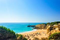 Beautiful sea view of sandy beach Pria do Castelo in Algarve stock images