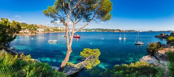 Beautiful sea view scenery of bay with boats on Majorca island, Spain. Idyllic island scenery, panorama view of bay with boats at Cala Fornells on Majorca Stock Images