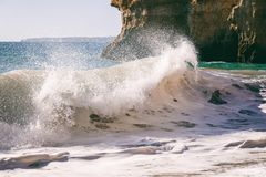 Beautiful sea view with secret sandy beach among rocks and cliff royalty free stock images