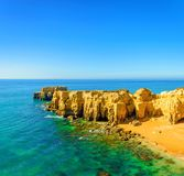 Beautiful sea view with secret sandy beach among rocks and cliffs near Albufeira in Algarve, Portugal royalty free stock image