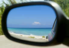 Beautiful sea view in side mirror of car. Beautiful turquoise sea view in side mirror of car Stock Image
