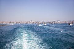 Beautiful sea view to a metropolis from a ferry. Royalty Free Stock Images