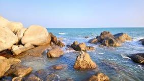 Beautiful sea waves at kanyakumari .india. Beautiful sea waves at kanyakumari india.clear sand,rushing waves.clear sky.beautiful rocks stock photo