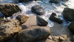 Beautiful sea waves ,rocks at kanyakumari .india. Beautiful sea waves ,rocksat kanyakumari india.beautiful rocks ,rushing waves royalty free stock photos